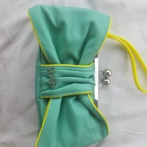Jessica Simpson teal and neon yellow green clutch